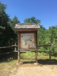 Trailhead marker for the Inga Trail on the Bull Creek District Park.